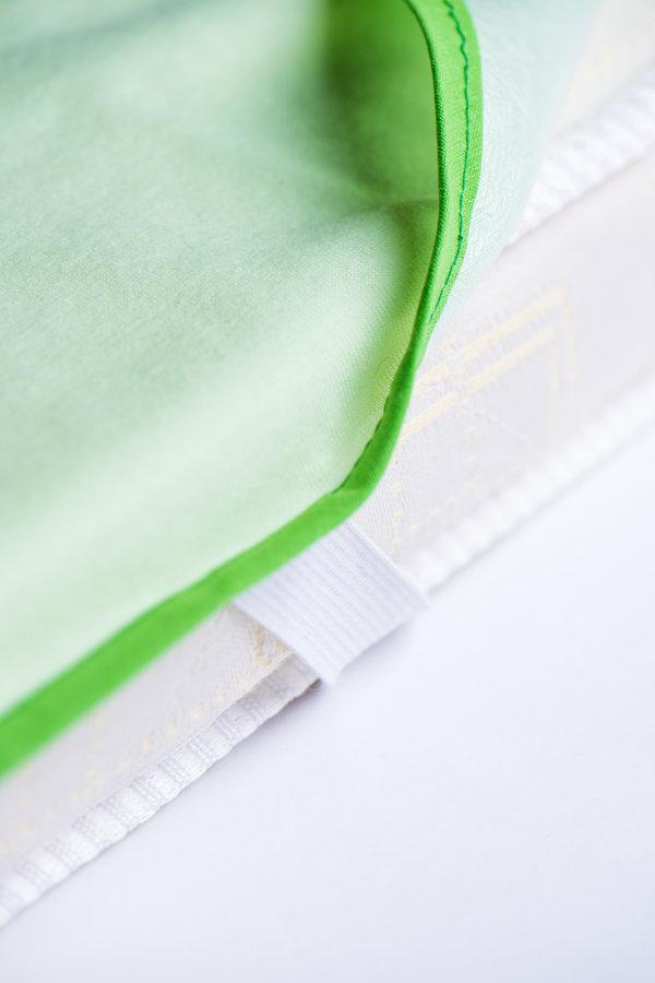 Aizsargpalags ar 4 gumijām gaiši zaļā krāsā